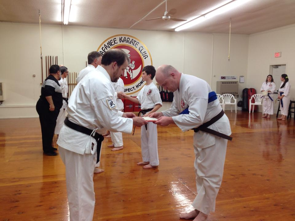 Receiving the certificate that goes with the belt.